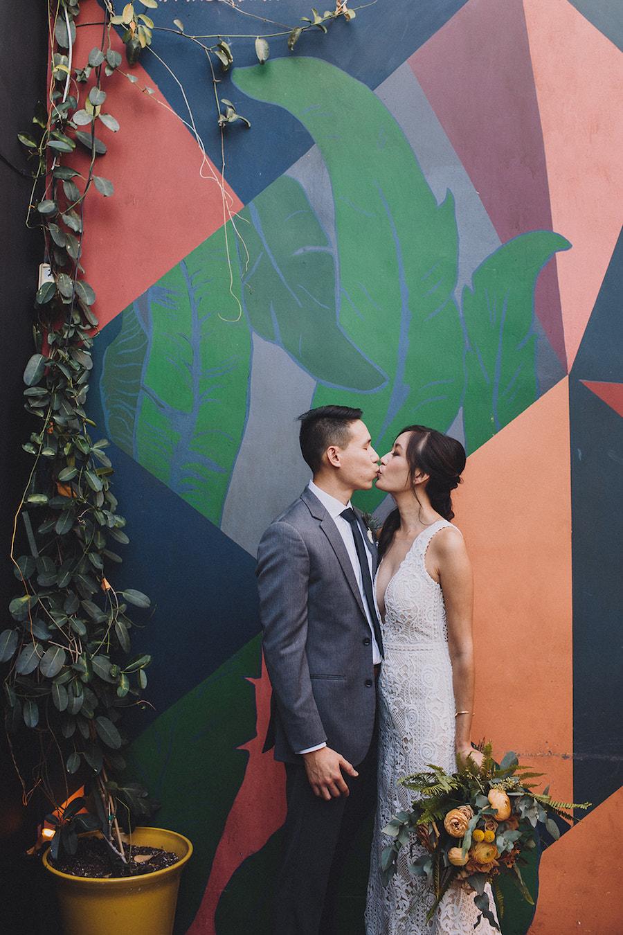 Madera Kitchen Wedding Bride and Groom Kissing