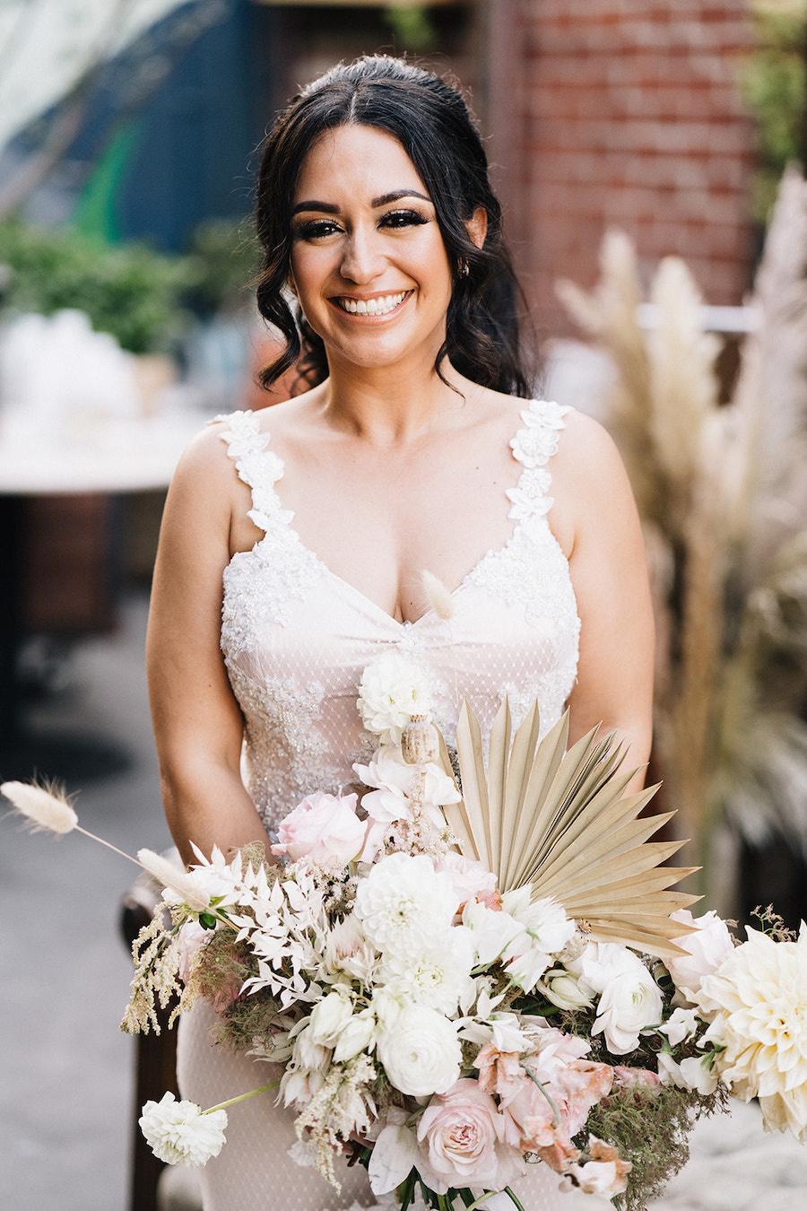 happy bride with pastel flower bouquet in los angeles