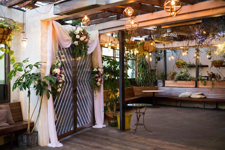 string lights at wedding ceremony at madera kitchen