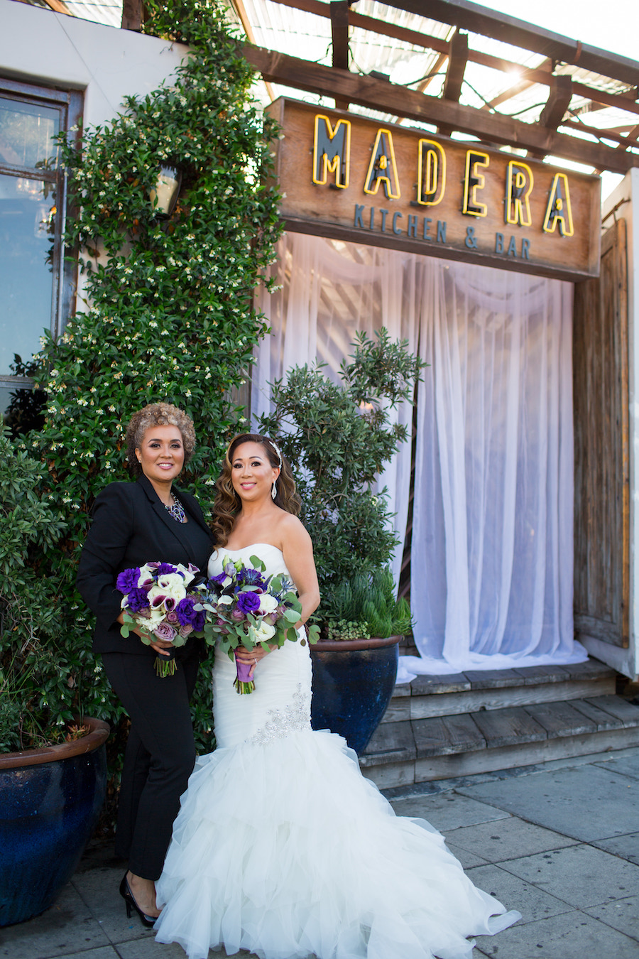 newlyweds in front of madera kitchen los angeles