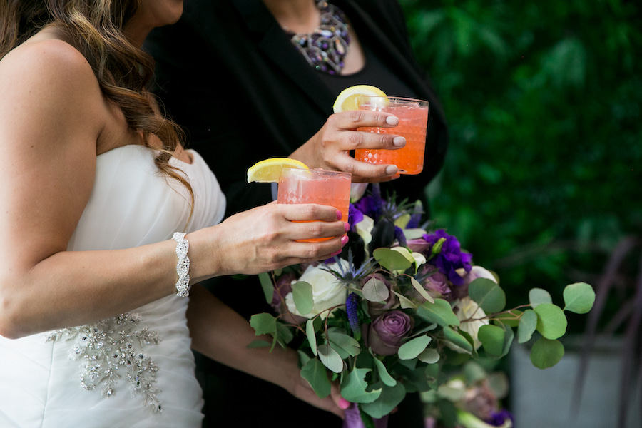 brides celebrating with cocktails at madera kitchen