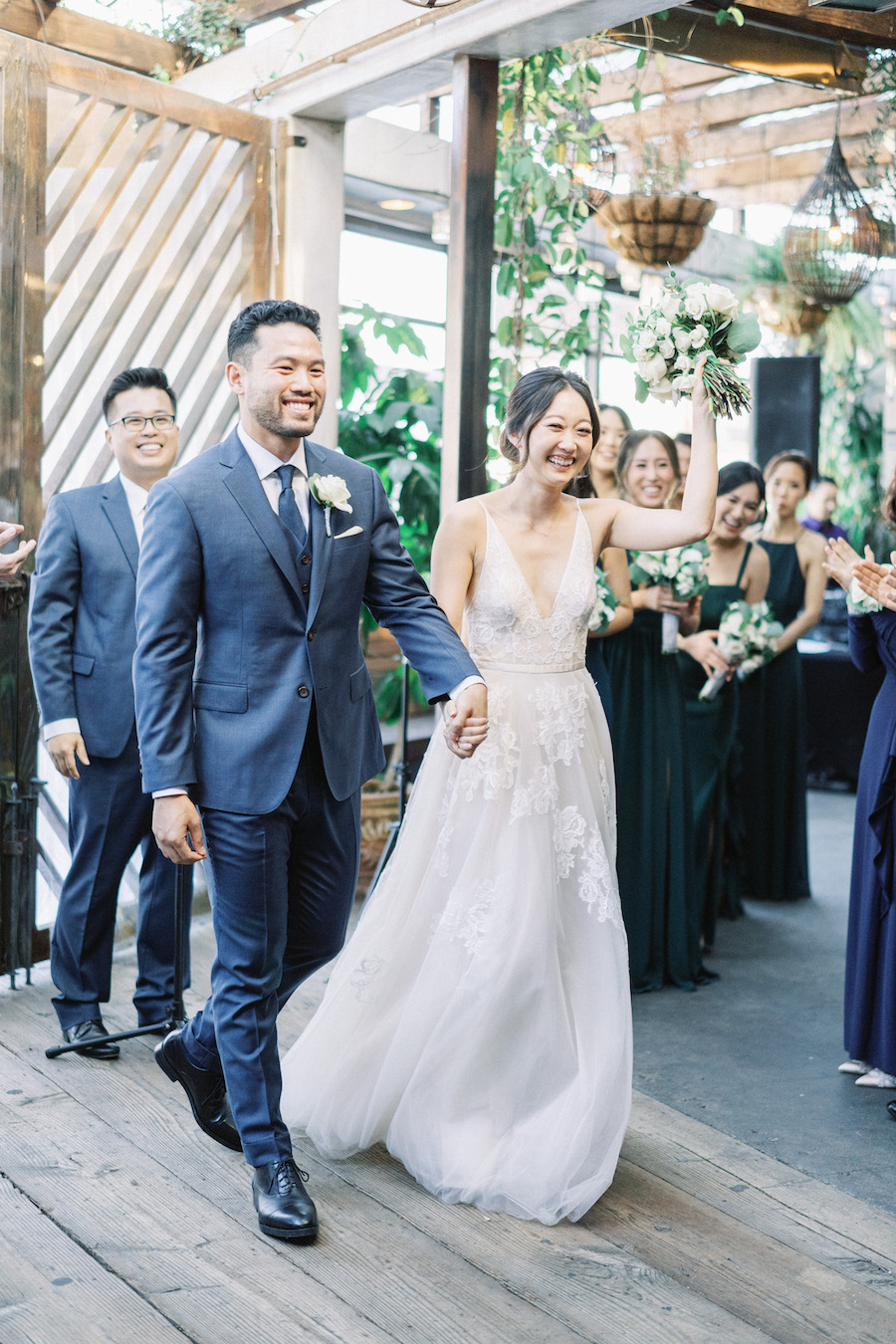 bride and groom happily walking down aisle in los angeles