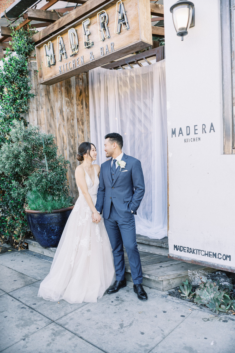newlyweds in front of madera kitchen la restaurant