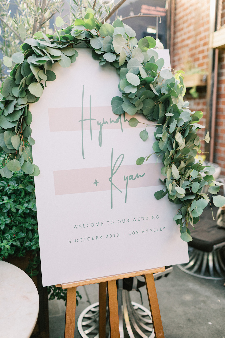 wedding ceremony sign with bride and grooms name