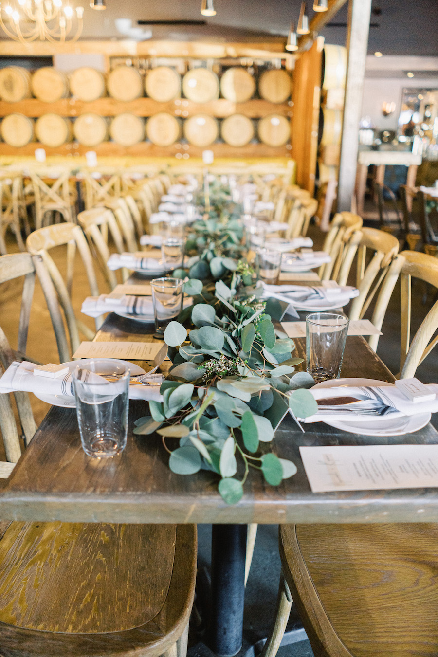tabletop decor with green leaves at wedding reception in los angeles