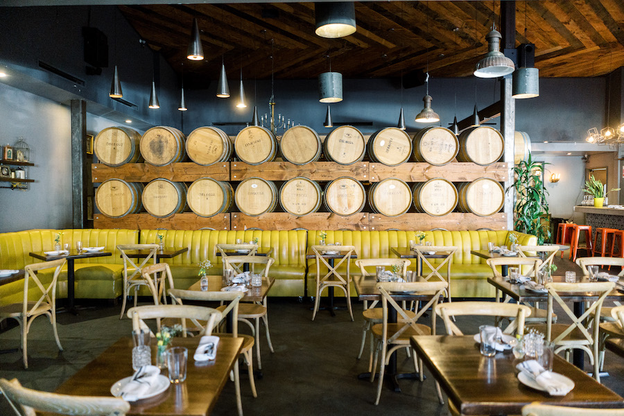 dining area for guests with a large wall of wooden barrel decor