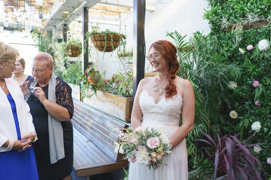 bride smiling at wedding reception at madera kitchen la