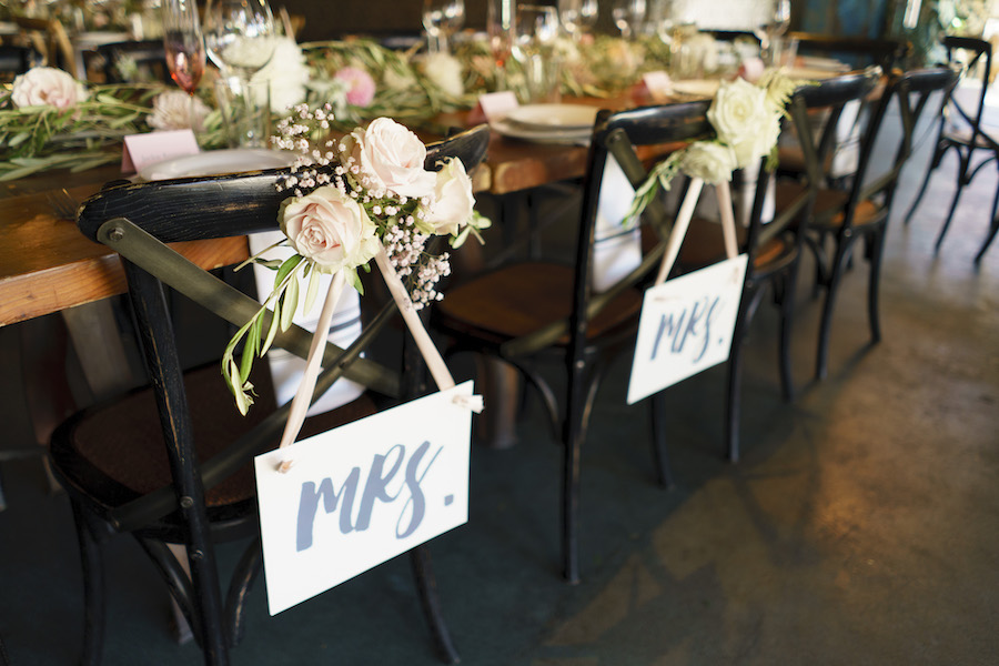 mrs sign on couple's chair at sweetheart table
