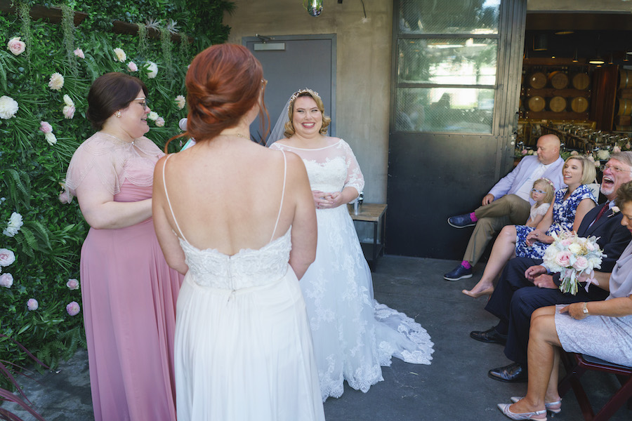 smiling brides at wedding ceremony in los angeles
