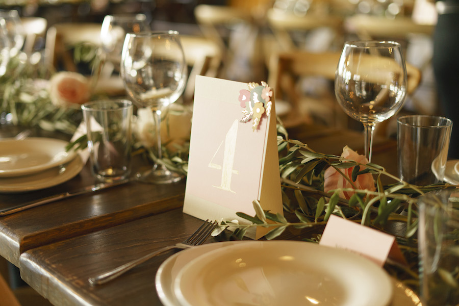 close up of tabletop decor at romantic wedding reception