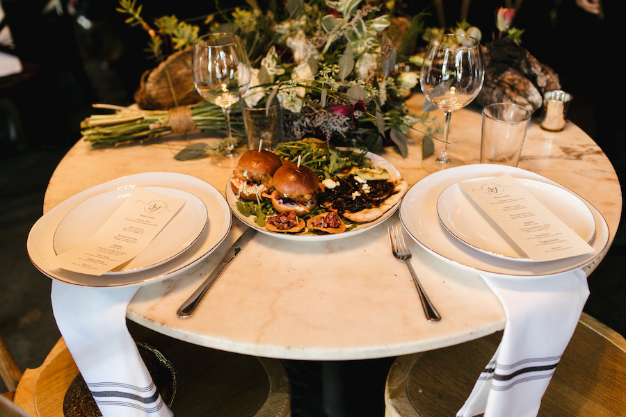 sweetheart table with food at wedding reception