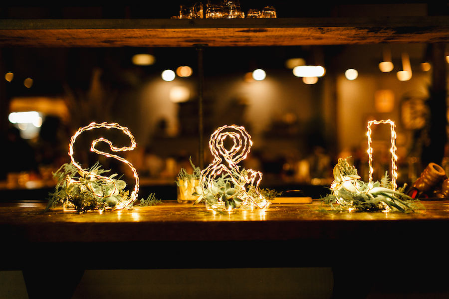 initials of bride and groom with string lights