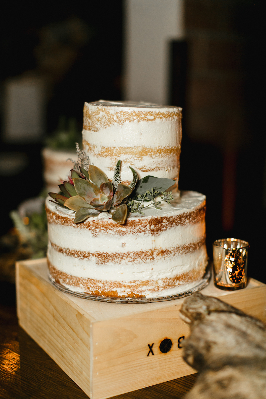 wedding cake with succulent design at wedding