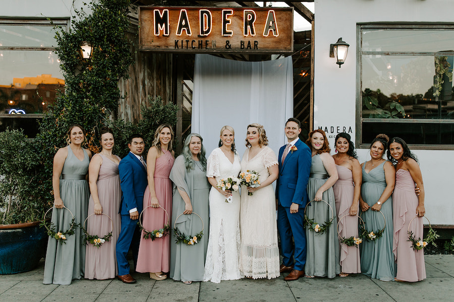 bridal party group photo in front of boho restaurant in los angeles