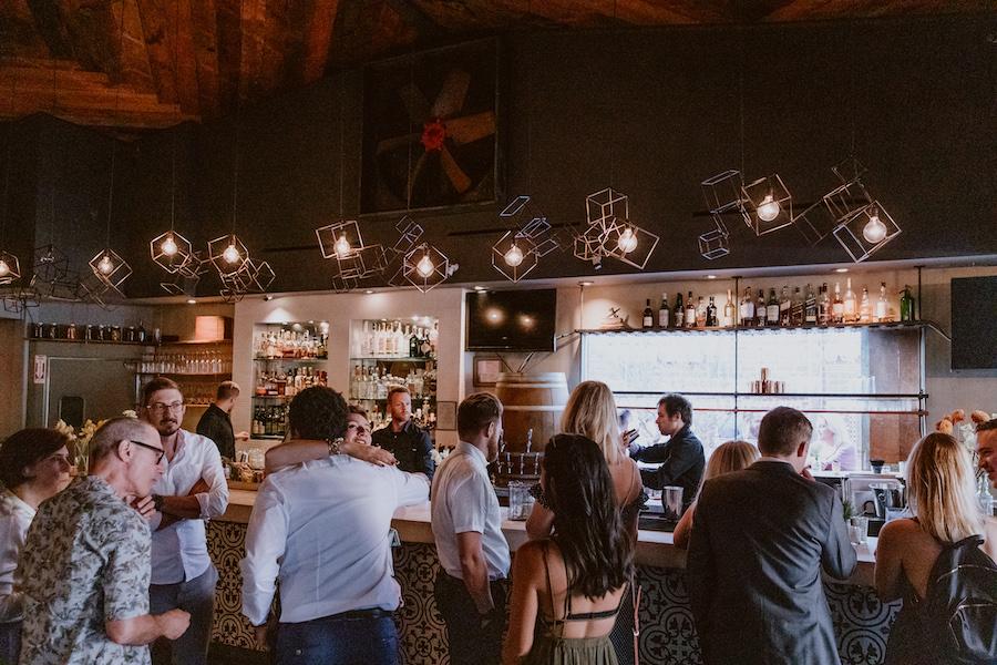 wedding guests at the bar in madera kitchen los angeles