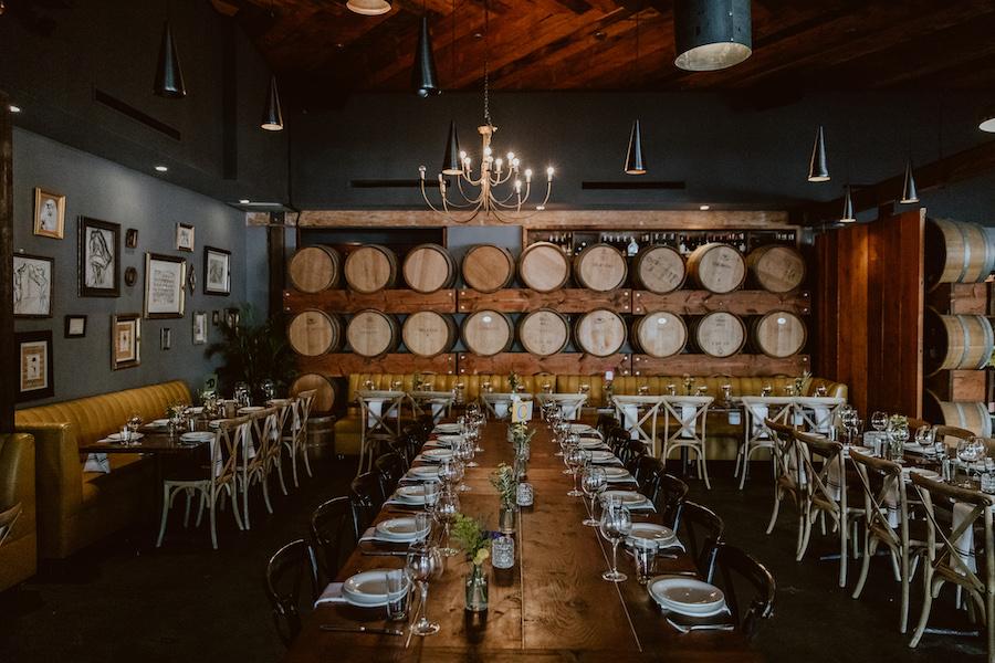 wedding reception guest tables in boho restaurant in los angeles
