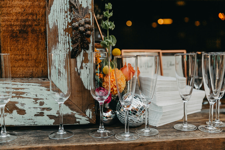 open bar with empty glasses at wedding reception
