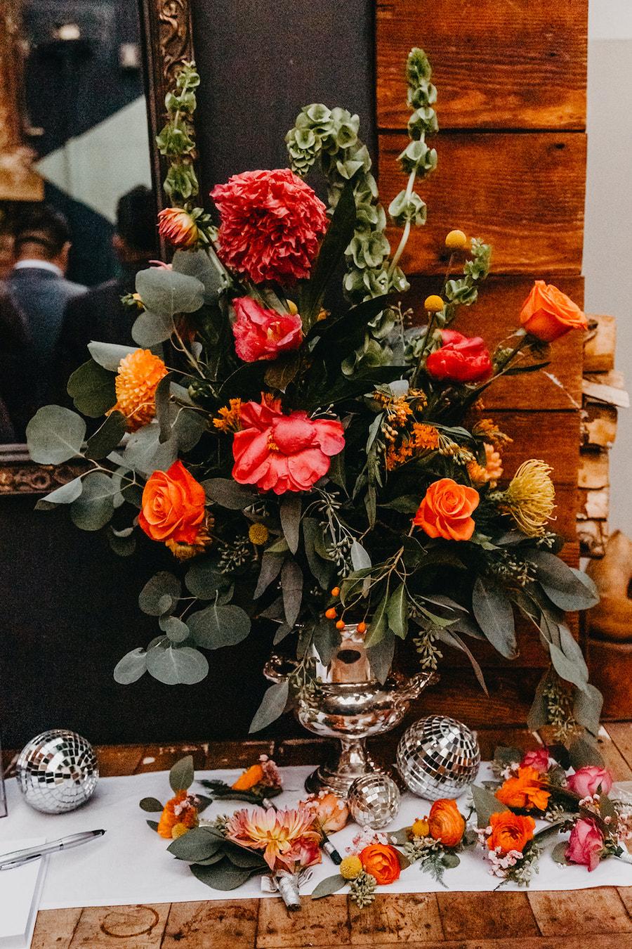 oversized floral arrangement at wedding reception