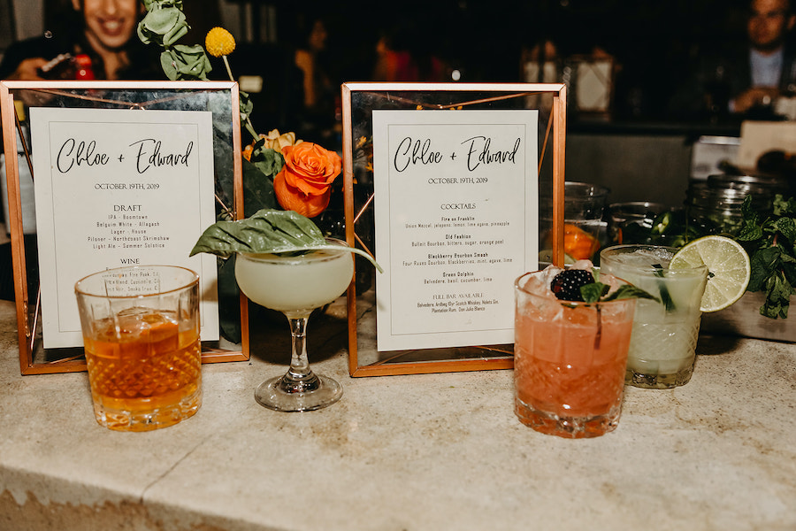 cocktail menu with cocktails at wedding reception